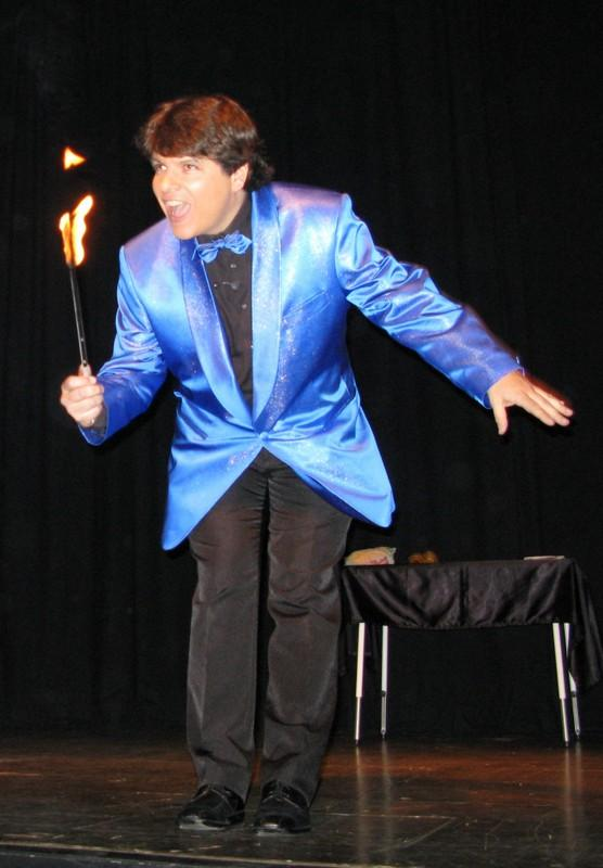 Magician Olivier OK MAGICS with flaming torch in Jubilée show Le Bouche à Oreille in Brussels may 2010