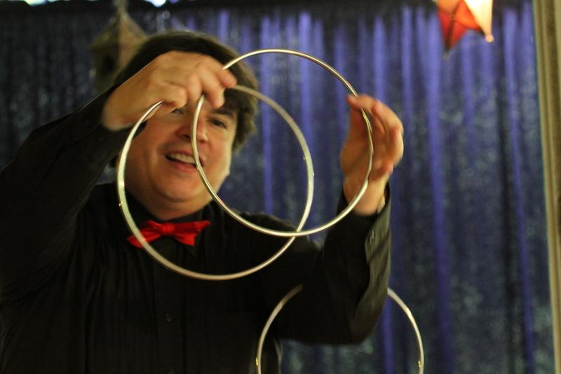 Magician Olivier OK MAGICS with Linking Rings in Belgium 2014