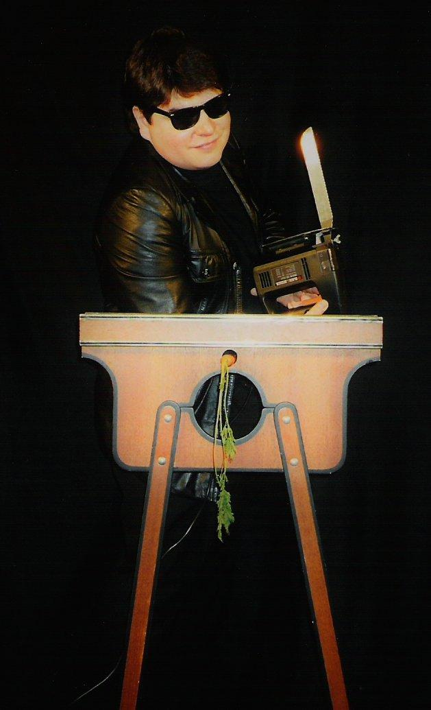 Magician Olivier OK MAGICS with electric saw illusion