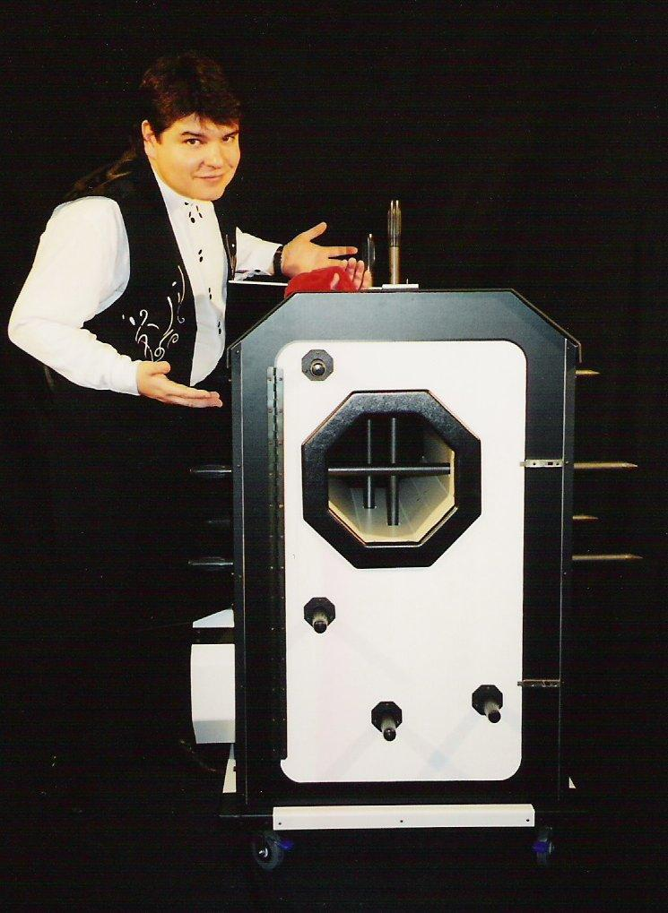 Magician Olivier OK MAGICS with Octocubus grand illusion