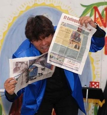 Magician Olivier OK Magics doing torn and restored newspaper trick in Tindaya Fuerteventura Spain summer 2010