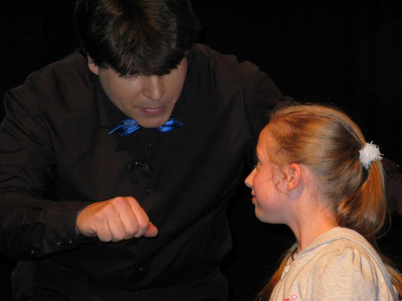 Magician Olivier OK MAGICS doing close-up trick during Jubilée Show in Brussels 2010