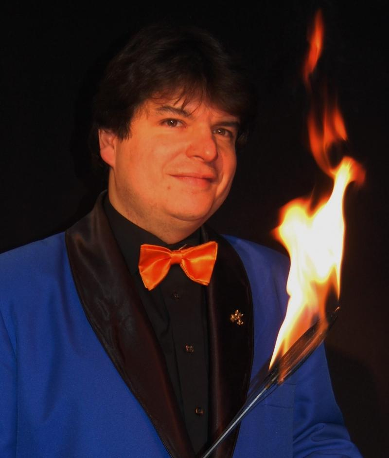 Magician Olivier OK MAGICS with flaming torch