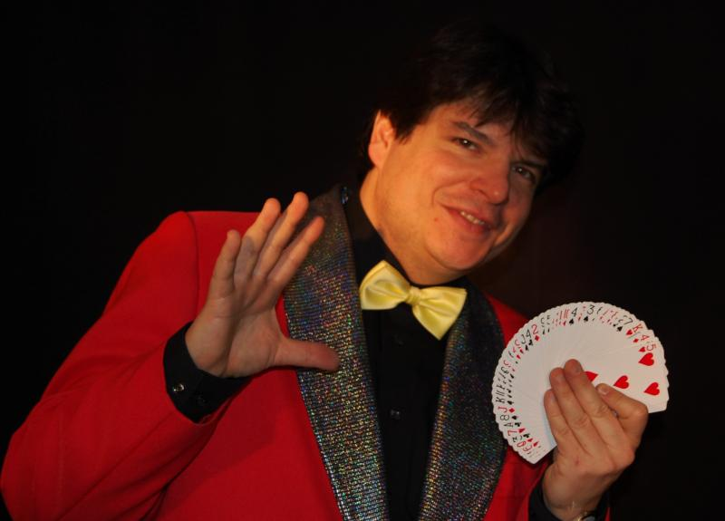Magician Olivier OK MAGICS with card fan