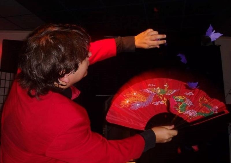 Magician Olivier Klinkenberg OK MAGICS flying butterflies stage magic trick in Tenerife Spain August 2015