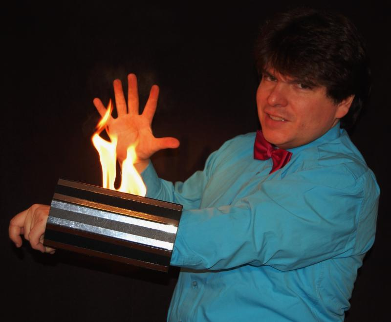 Magician Olivier OK MAGICS with burning arm