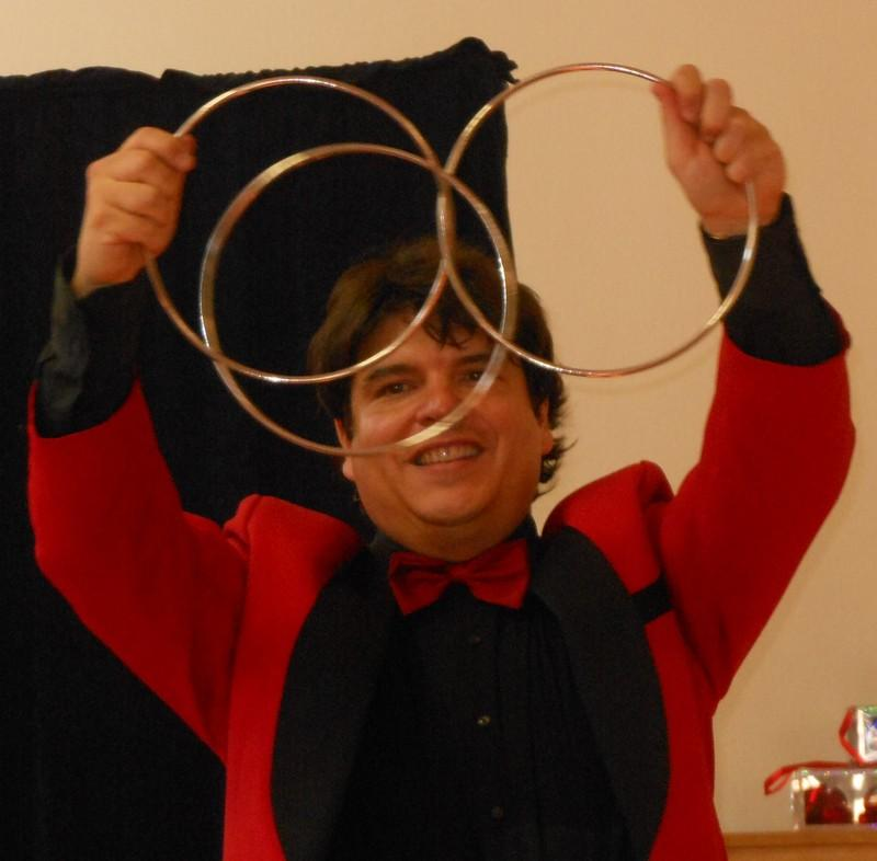 Magicican Olivier OK MAGICS performing Linking Rings in Bourgogne France 2012