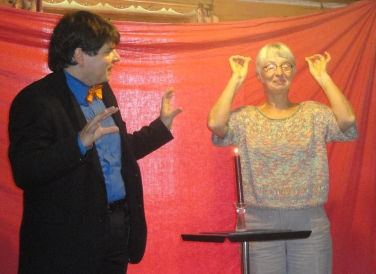 Magician Olivier OK MAGICS interacting with magical spectator during close-up show in Bourgogne France 2010