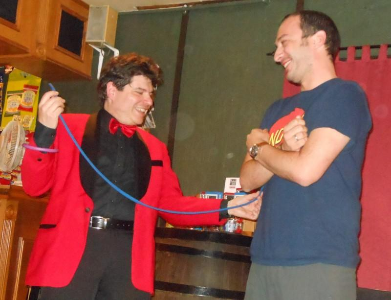Magician Olivier OK MAGICS performing close-up magic in a pub in Scotland UK