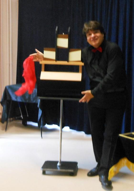 Magician Olivier OK MAGICS performing Trisection Illusion in Bourgogne France 2012