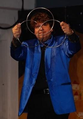 Magician Olivier OK MAGICS performing Linking Rings in Tindaya Fuerteventura in Summer 2010