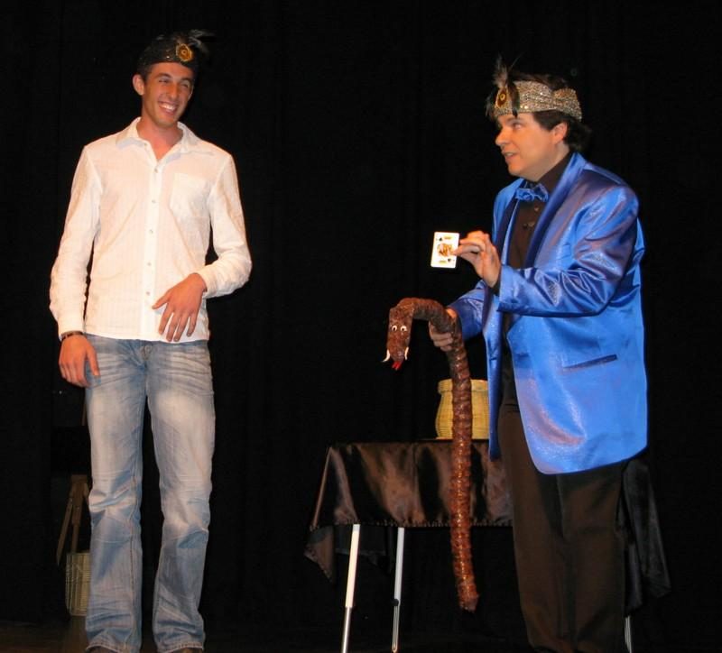 Magician Olivier OK MAGICS peforming fakir trick with spectator during his Jubilée Show in Brussels 2010
