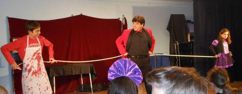 Magician Olivier OK MAGICS interacting with two children in Spain Halloween Tour 2014