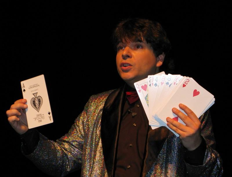 Magician Olivier OK MAGICS performing jumbo card trick during Jubilée Show in Brussels 2010