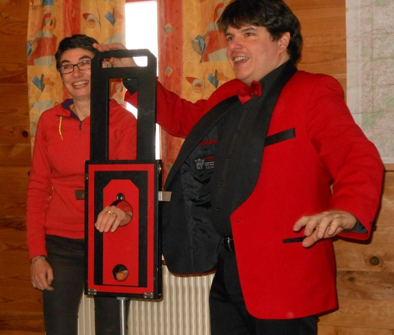 Magician Olivier OK MAGICS performing Arm Guillotine in Bourgogne France 2013