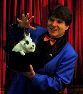 Magician Olivier OK MAGICS with appearing rabbit from a hat