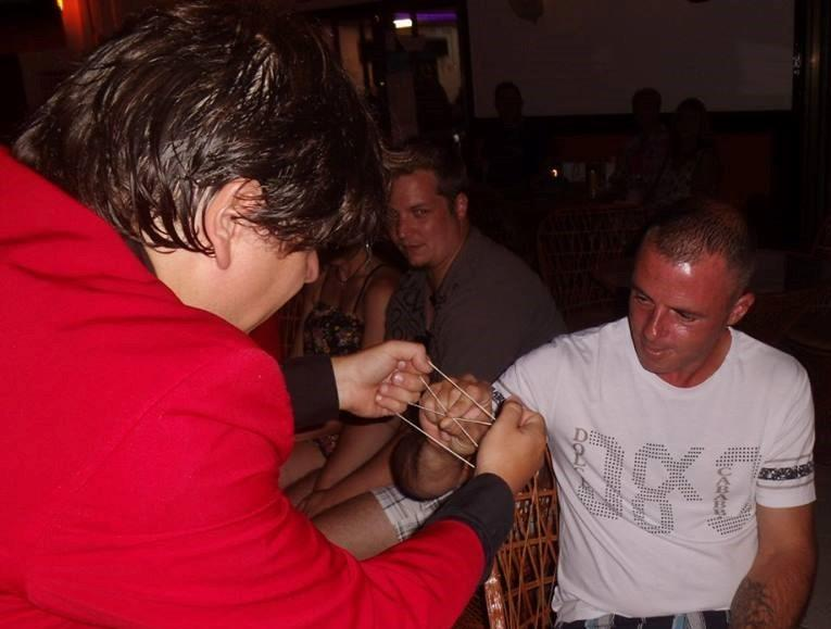 Magician Olivier Klinkenberg OK MAGICS interactive close-up magic trick with spectator in a bar in Tenerife Spain  July 2015