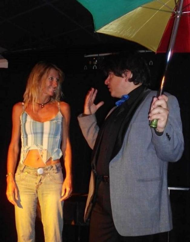 Magician Olivier Klinkenberg OK MAGICS interactive stage magic trick with spectator and umbrella in Tenerife Spain August 2015